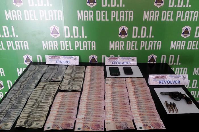Policial DDI dinero y armas