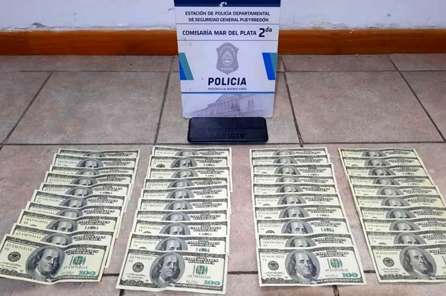 Detuvieron a una joven por comprar celulares con dólares falsos